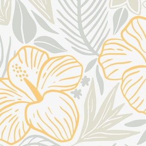 Tropical leaves and flowers in light colors