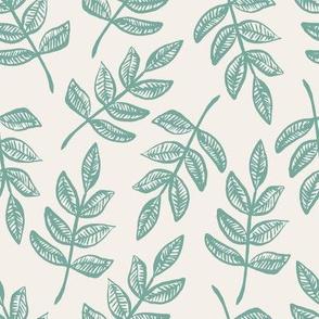 green leaves on cream