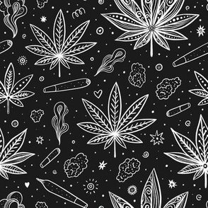 Cannabis leaves and joints on chalkboard