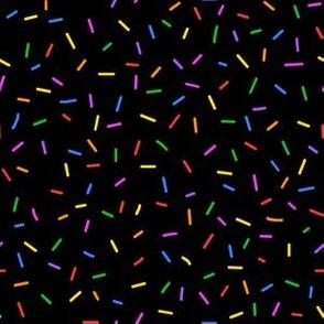 Rainbow sprinkles on black