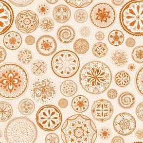Hand-drawn orange mandala designs