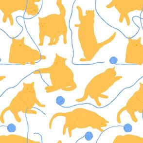 Orange cats and Yarn White Backgroun