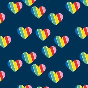 Rainbow love hearts confetti pride gay on navy blue