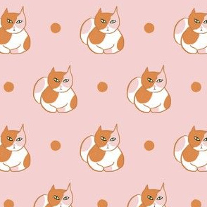Ginger pink calico cat with dot
