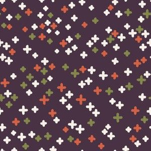 Hand drawn colored crosses on the dark background.