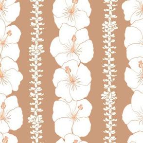 hibiscus and puakenikeni lei on tan nude
