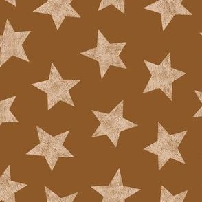 Hand printed stars on brown