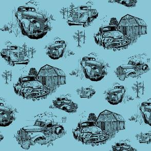 Toile of vintage trucks on blue