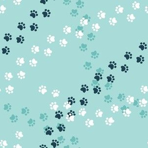 Small scale // Hot dogs chase // aqua background navy blue and white paw prints