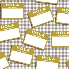 insignia hola me llamo - mustard on grey