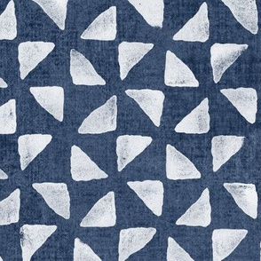 Block Print Triangles on Blue Grey Denim (xl scale) | Pinwheel triangles from hand carved block, white on faded denim.
