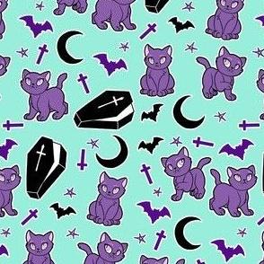 Goth Black cats on bright mint blue