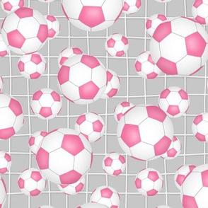 pink and white soccer balls w goal net detail on gray