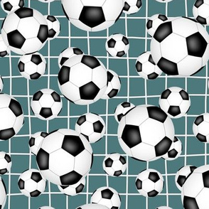 black and white soccer balls w goal net detail pattern on teal