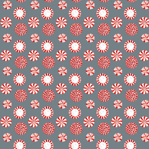 Peppermint candies on gray