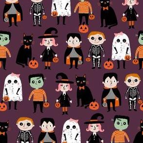trick or treat - cute halloween kids in costumes fabric - dark purple