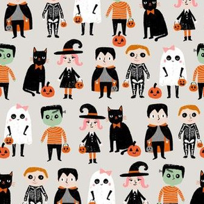 trick or treat - cute halloween kids in costumes fabric - sand