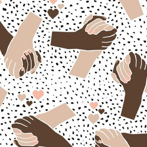 Black Lives Matter hand in hand against racism friendship and love white brown blush