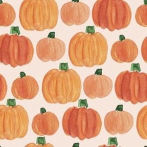 pumpkins on pale orange