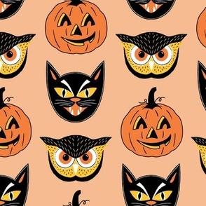 Vintage Halloween Face Masks on Orange