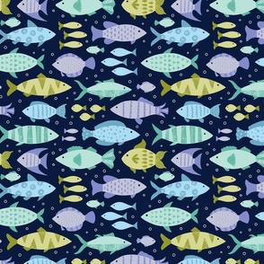 Blue and Green Fish Swim at the Lake