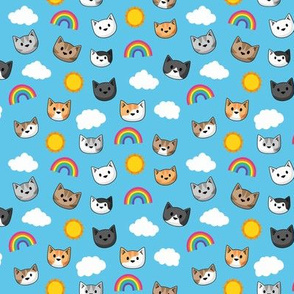 Cat heads with rainbows and sunshine