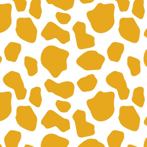 gold and white cow spots