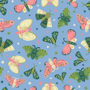 Decorative Moths on Blue