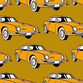 1963 Studebaker Avanti in orange on brown background