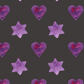 Purple hearts and stars on dark