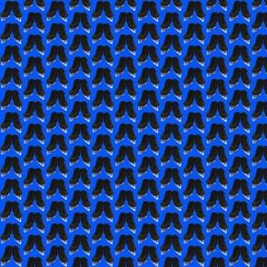 Offset Black Figure Skates on Royal Blue