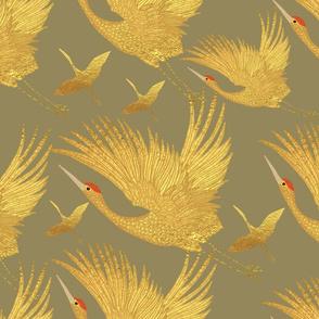 large ornate golden cranes on gold