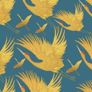 large ornate golden cranes on ocean blue