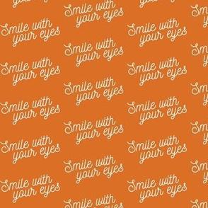 Smile with your eyes - white on orange - mask