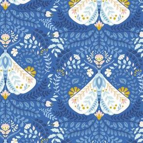 White moth on blue