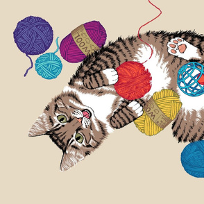 Cat playing with yarn tea towel - on light background