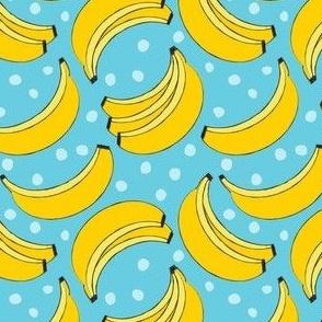 geometric bananas and dots on blue