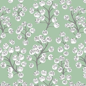 Delicate garden snow berries and poppy seeds classic winter Christmas mint gray white