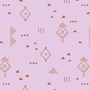 Messy tribal minimal mudcloth boho triangles and aztec details marroccan rug inspired design neutral nursery lilac purple copper rust trend girls