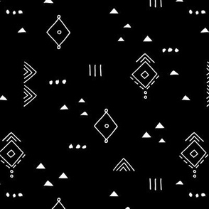 Messy tribal minimal mudcloth boho triangles and aztec details marroccan rug inspired design neutral nursery monochrome white on black