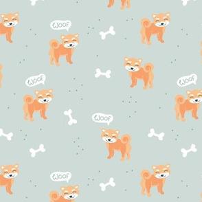 Woof! Barking kawaii shiba inu puppy dog paws and bone minty green