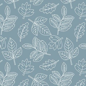 Delicate Scandinavian boho style autumn leaves oak maple and birch cool blue winter baby nursery