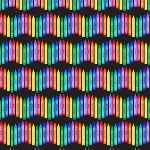 Rainbow crayons on black