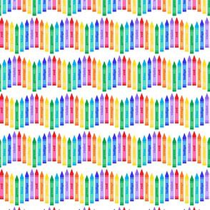 Rainbow crayons on white
