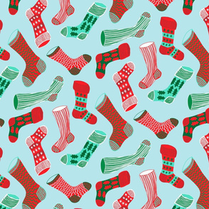 Christmas stockings red and green on pale blue