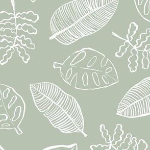 Tropical lush garden jungle leaves neutral island boho nursery design sage green