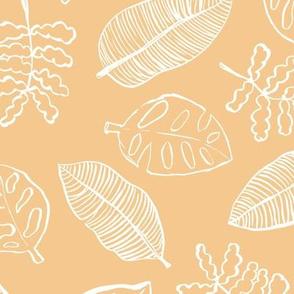 Tropical lush garden jungle leaves neutral island boho nursery design honey yellow white
