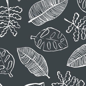 Tropical lush garden jungle leaves neutral island boho nursery design charcoal gray white