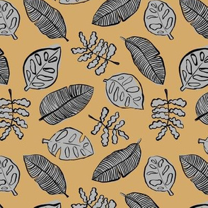 Tropical lush garden jungle leaves neutral island boho nursery design mustard yellow gray