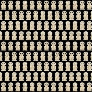mummies black background